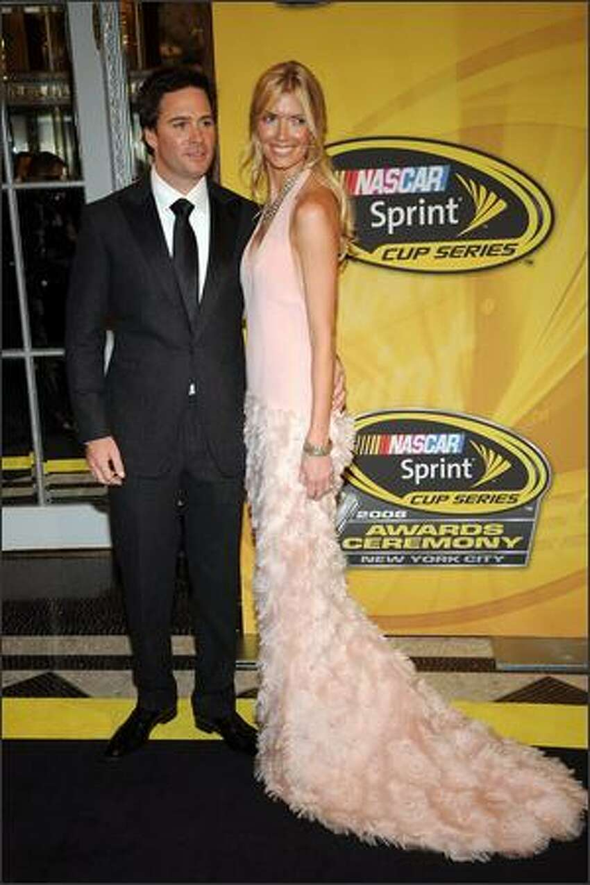 2008 NASCAR Sprint Cup Series champion Jimmie Johnson and his wife Chandra arrive.
