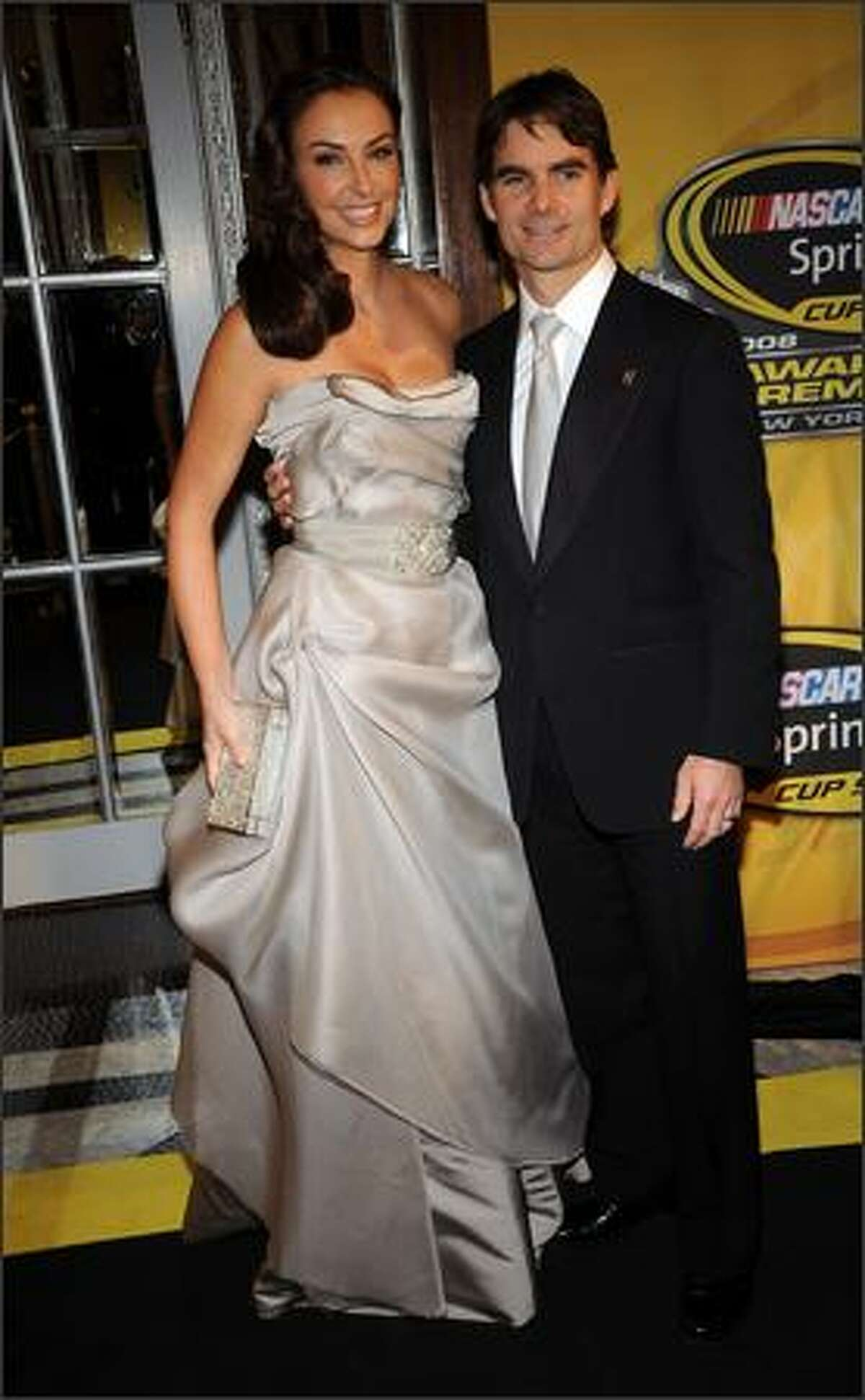 Jeff Gordon, driver of the #24 Dupont Chevrolet, and his wife Ingrid Vandebosch, arrive.