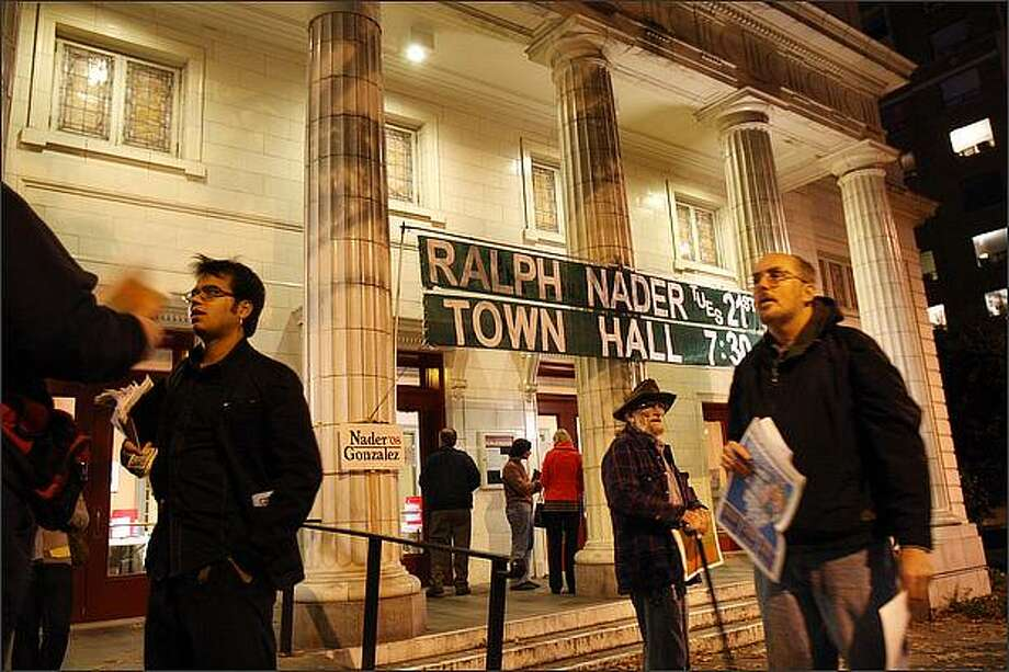 "Fliers, pamphlets, and independent newspapers are distributed outside a rally with Ralph Nader at Seattle's Town Hall. Steve Leigh (right) with the International Socialist Organization distributes the newspaper ""Justice."" Fred ""Fritz"" Pitts, (center) from Seattle, with the Socialist Alternative makes his point. ""All the minor parties are cut out and I feel that when they have a presidential debate it should include all the candidates."" October 22, 2008 Photo: Karen Ducey, Seattle Post-Intelligencer"