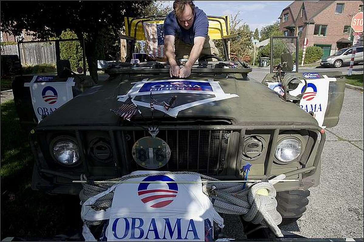 """Nole Poulsen uses his vintage 1968 M-715 Army truck as a political billboard. """"I use it as a billboard for progressive causes,"""" says Poulsen. """"I don't care what side they're on, as long as they enter the argument."""" October 21, 2008"""