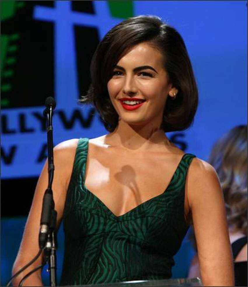 Actress Camilla Belle presents onstage during the Hollywood Film Festival's Gala Ceremony held at Beverly Hilton Hotel on Tuesday in Beverly Hills, Calif.
