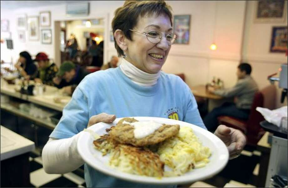 Sally Norton delivers a chicken-fried steak breakfast ($8.99) at the Chelan Cafe. The kitchen makes sure the meat is tender and well-coated, the gravy is salty and the two eggs are cooked any style. The 70-year-old Chelan Cafe shows signs of lasting another seven decades. Photo: Meryl Schenker/Seattle Post-Intelligencer