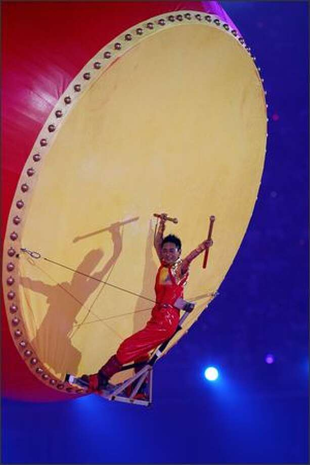 A musician plays a giant drum during the Closing Ceremony for the Beijing 2008 Olympic Games on Sunday in Beijing. Photo: Getty Images