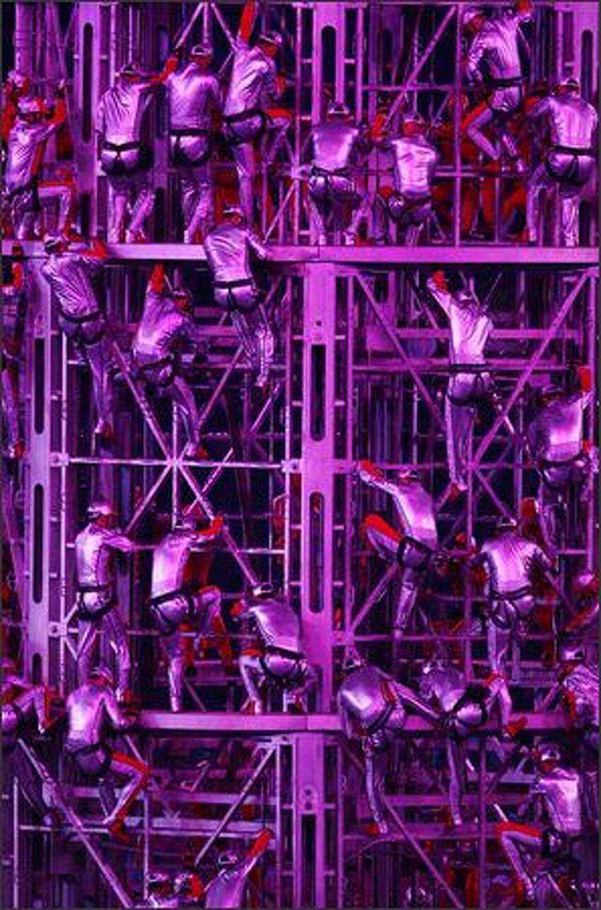 Acrobats perform during the Closing Ceremony for the Beijing 2008 Olympic Games on Sunday in Beijing.