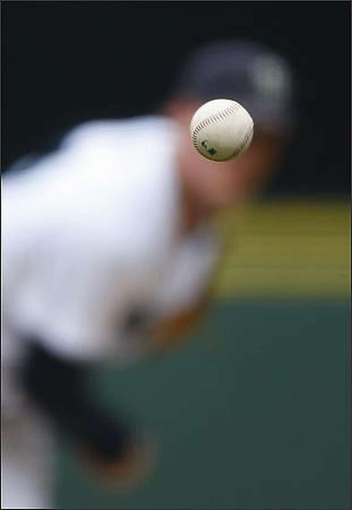 Mariners pitcher Mark Lowe fires a 95-mph fastball to a Minnesota Twins batter at Safeco Field.