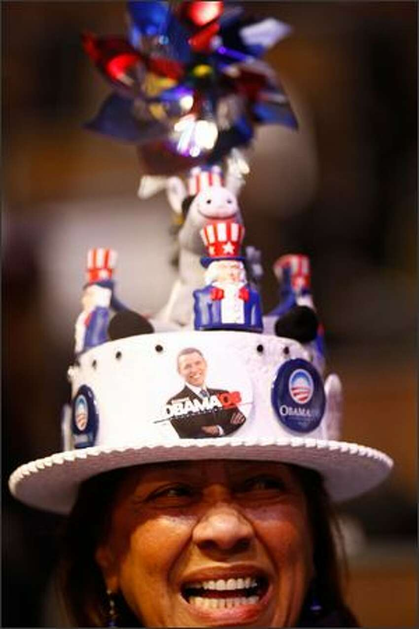 A women smiles while wearing a hat during day one of the Democratic National Convention (DNC) at the Pepsi Center on Monday in Denver, Colorado.