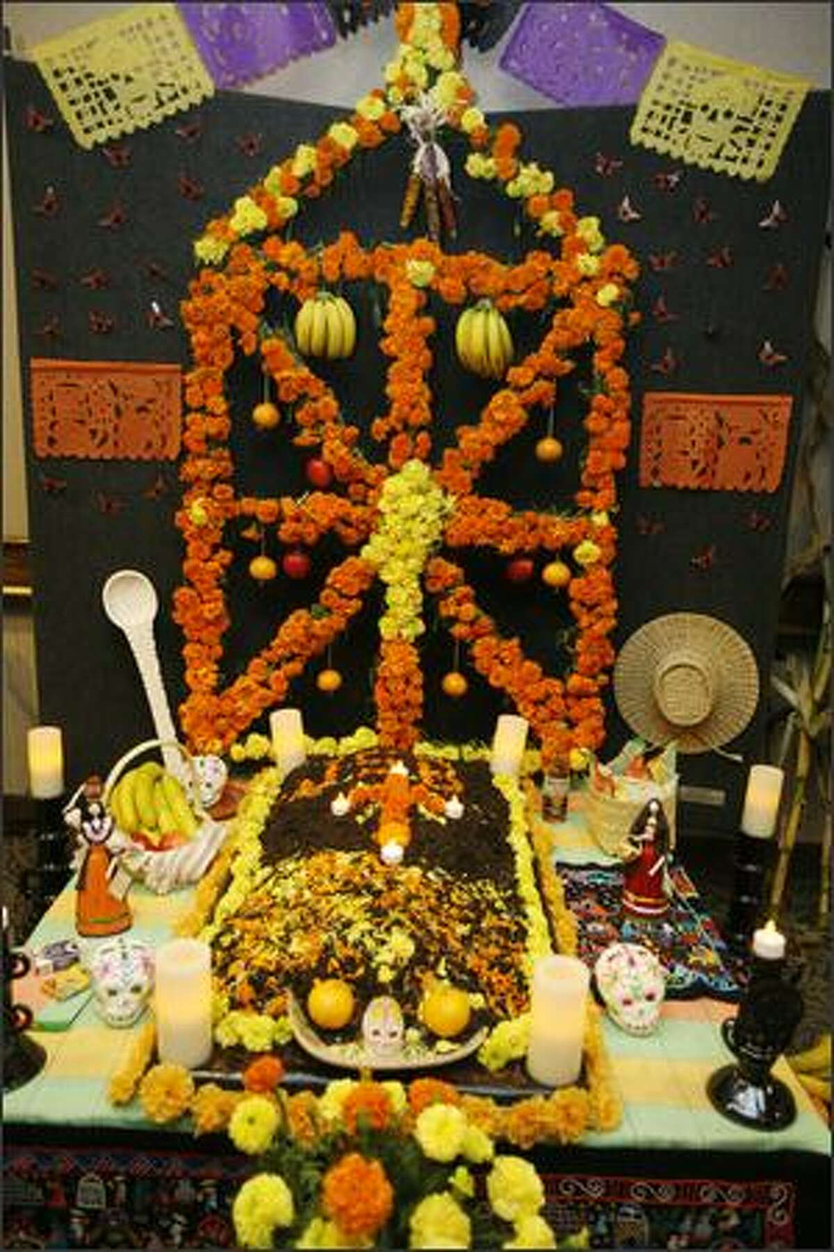 A Dia de Muertos altar on exhibit.