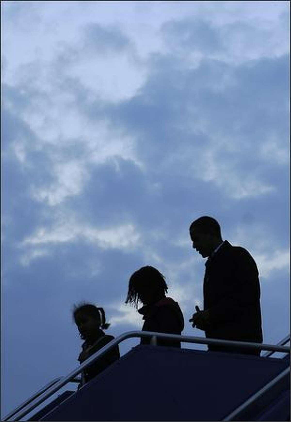 Democratic presidential candidate Illinois Senator Barack Obama and his daughters Sasha, 7, and Malia, 10, disembark from his campaign plane in Columbus, Ohio, on Sunday.