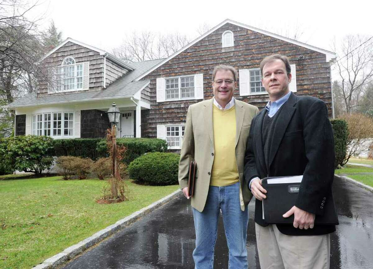 From left, Gary Ferrari and Peter Schattenfield, both managing partners of Turning Point Estate Services of Wilton, Conn., posed in front of a home at 58 Longmeadow Road, Greenwich, Wednesday afternoon, March 23, 2011.