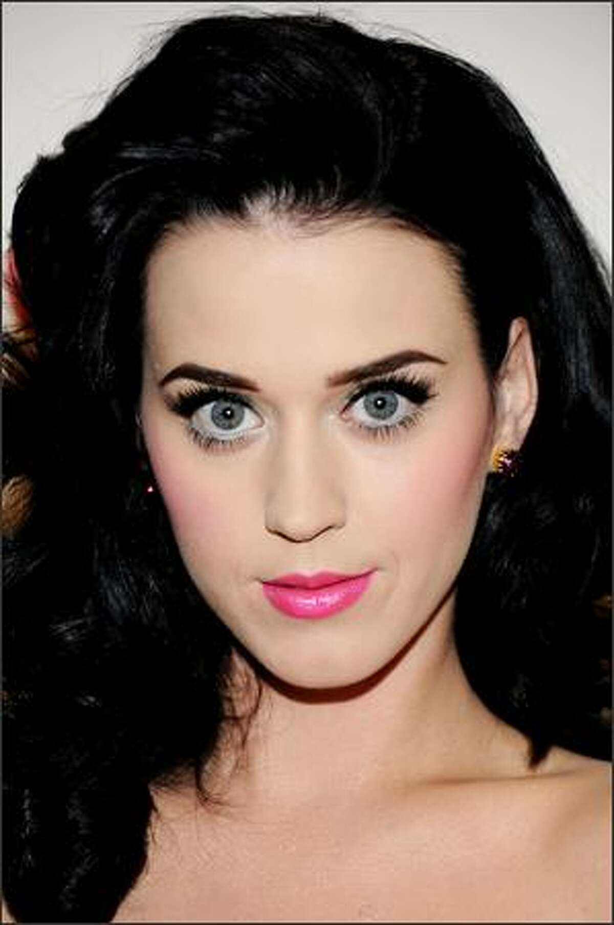 Host Katy Perry arrives.