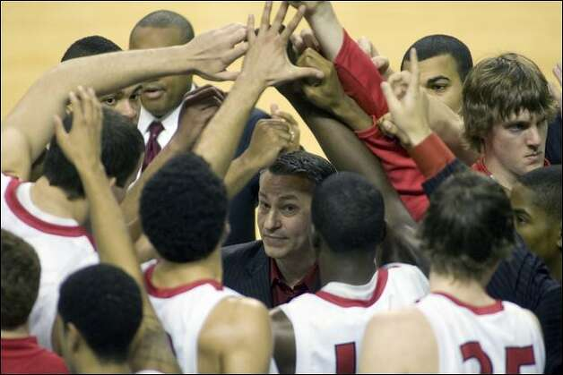 Seattle U coach Joe Callero, center, talks to his players during a timeout in the second half. Callero's Redhawks are 8-5. Photo: Jim Bryant/Seattle Post-Intelligencer