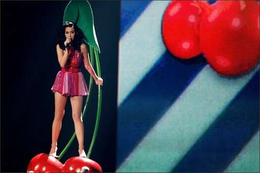 Katy Perry performs on a giant pair of cherries. Photo: Getty Images