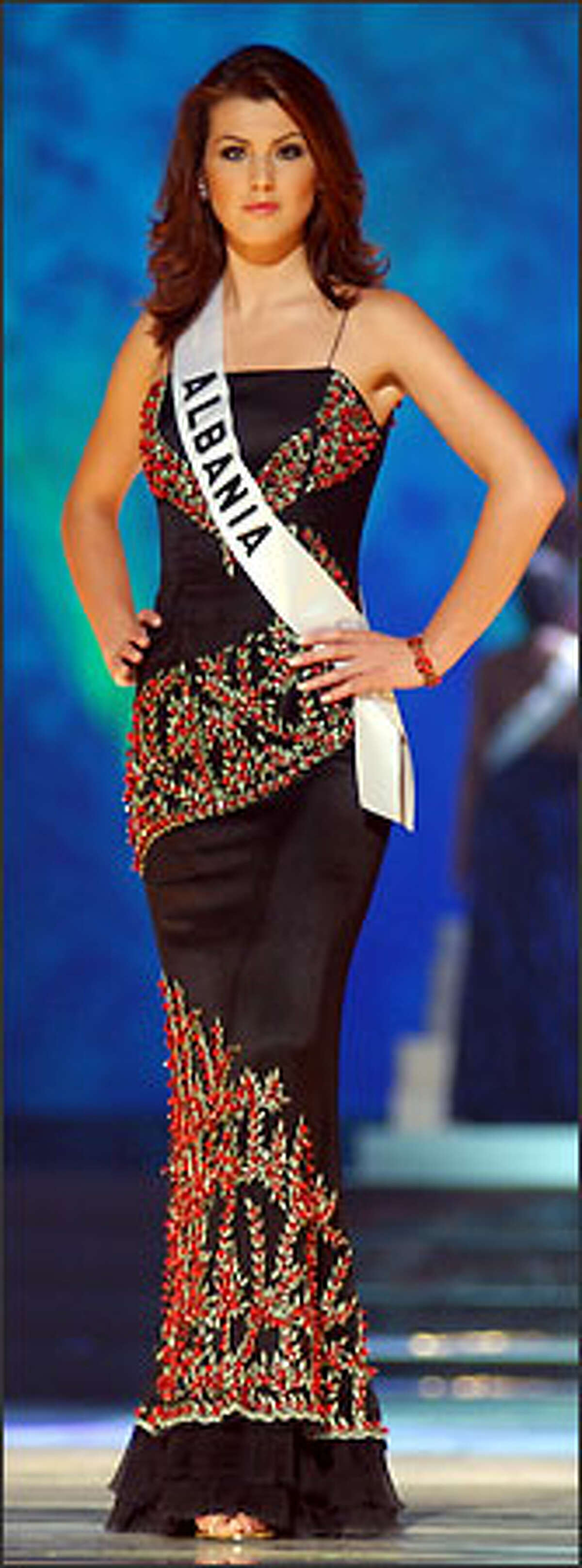 Denisa Kola, Miss Albania 2003, from Peshkopia, competes May 29, 2003 in her choice of evening gown during the 2003 Miss Universe Presentation Show at the Panama Canal Village Convention Center in Panama City, Panama. During the Presentation Show, each Miss Universe delegate is judged by a preliminary panel of distinguished judges in three categories. These categories consist of individual interview, swimsuit competition and evening gown competition. The scores are tallied and the Top 15 delegates will be announced during the LIVE broadcast of the 52nd annual Miss Universe competition on Tuesday, June 3, 2003 from Panama City, Panama on NBC at 9:00 PM (ET)/8 PM (CT) (delayed PT). ho/MISS UNIVERSE L.P., LLLP