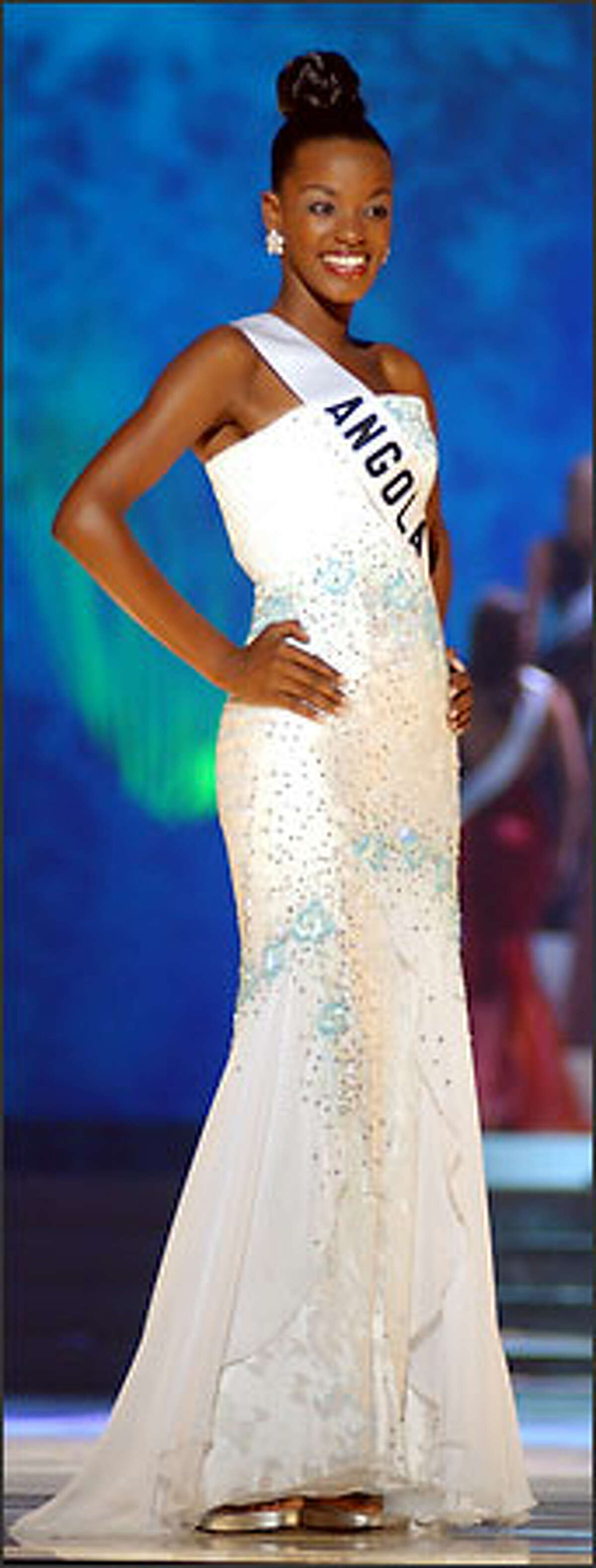Ana Sebastio, Miss Angola 2003, from Luanda, competes May 29, 2003 in her choice of evening gown during the 2003 Miss Universe Presentation Show at the Panama Canal Village Convention Center in Panama City, Panama. During the Presentation Show, each Miss Universe delegate is judged by a preliminary panel of distinguished judges in three categories. These categories consist of individual interview, swimsuit competition and evening gown competition. The scores are tallied and the Top 15 delegates will be announced during the LIVE broadcast of the 52nd annual Miss Universe competition on Tuesday, June 3, 2003 from Panama City, Panama on NBC at 9:00 PM (ET)/8 PM (CT) (delayed PT). ho/MISS UNIVERSE L.P., LLLP