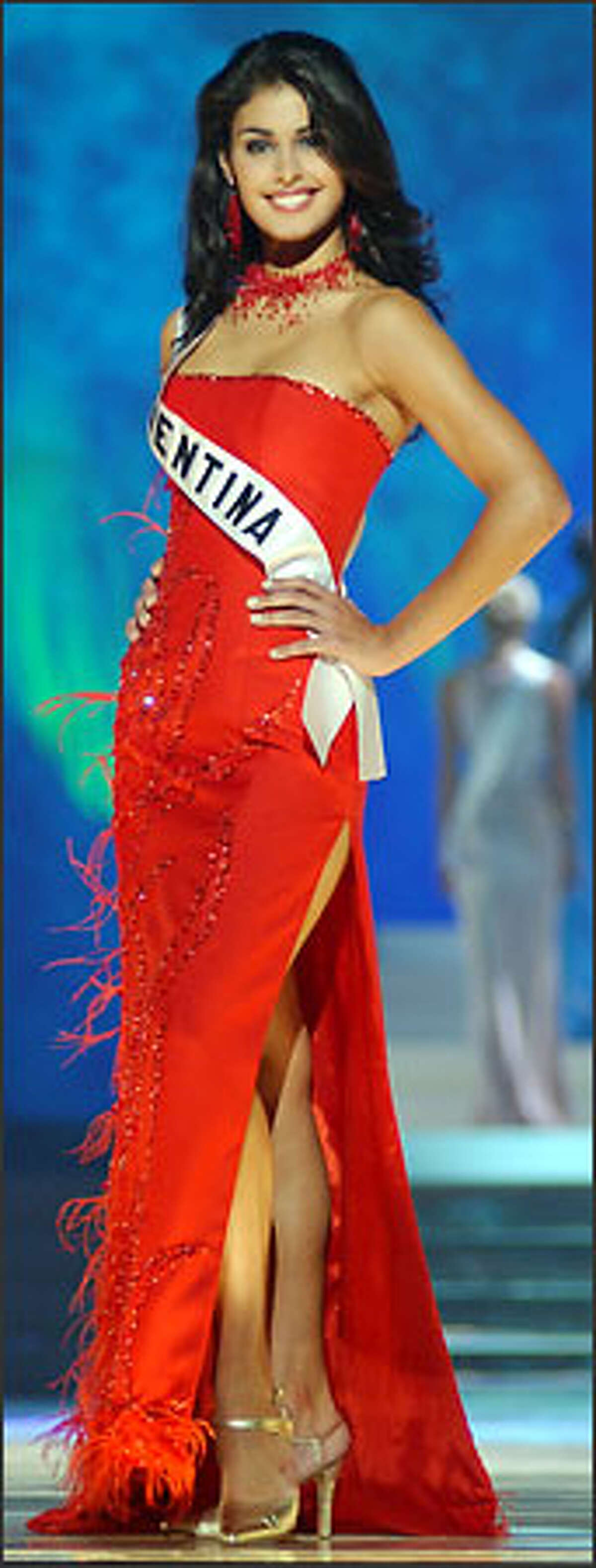 Laura Romero, Miss Argentina 2003, from La Plata, competes May 29, 2003 in her choice of evening gown during the 2003 Miss Universe Presentation Show at the Panama Canal Village Convention Center in Panama City, Panama. During the Presentation Show, each Miss Universe delegate is judged by a preliminary panel of distinguished judges in three categories. These categories consist of individual interview, swimsuit competition and evening gown competition. The scores are tallied and the Top 15 delegates will be announced during the LIVE broadcast of the 52nd annual Miss Universe competition on Tuesday, June 3, 2003 from Panama City, Panama on NBC at 9:00 PM (ET)/8 PM (CT) (delayed PT). ho/MISS UNIVERSE L.P., LLLP