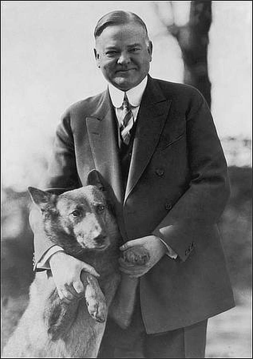 circa 1935: Herbert Hoover (1874 - 1964), the 31st President of the United States, with his dog. (Photo by Library Of Congress/Getty Images)