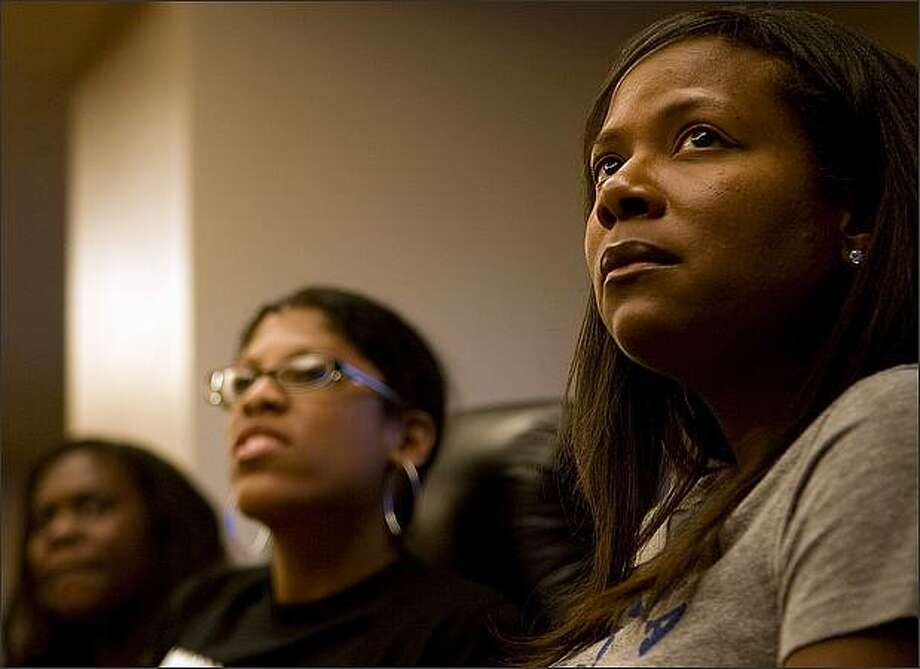 Listening, from right, Dana Chenevert, Jacqueline Justice, and Jamila Taylor with the Urban League, gather at Crown Plaza Hotel to watch Barack Obama's nomination speech. Photo: Grant M. Haller, Seattle Post-Intelligencer