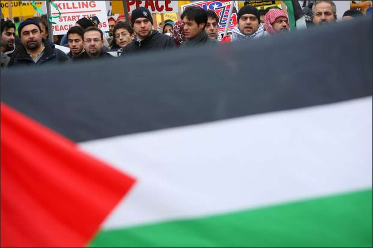 Supporters of Palestine march through downtown Seattle.