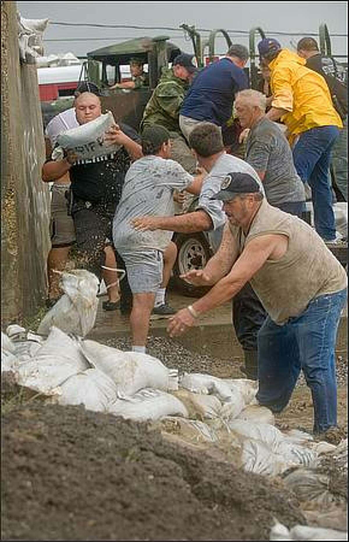 St. Bernard first responders, including trustees from the St. Bernard Parish Prison, work on stopping the flooding underneath the floodgate at the EBT Cranes building at the St. Bernard Parish and Plaquemines Parish border in the wake of Hurricane Gustav. Matthew Hinton/AFP/Getty Images