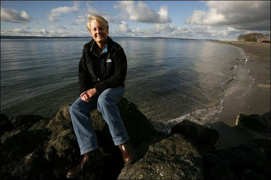 Sue Joerger, shown Friday at Golden Gardens Park, has been at the helm of the Puget Soundkeeper Alliance in its 2 1/2-year burst of litigation against governments and businesses believed to be in violation of the Clean Water Act, which allows citizens to sue individual polluters. Photo: Paul Joseph Brown/P-I