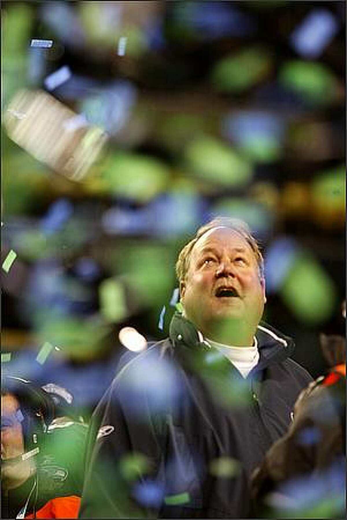 Coach Mike Holmgren watches as confetti falls during the trophy ceremony following the NFC Championship game won by the Seattle Seahawks over the Carolina Panthers at Qwest Field Sunday, Jan. 22, 2006. P-I Photo/Scott Eklund