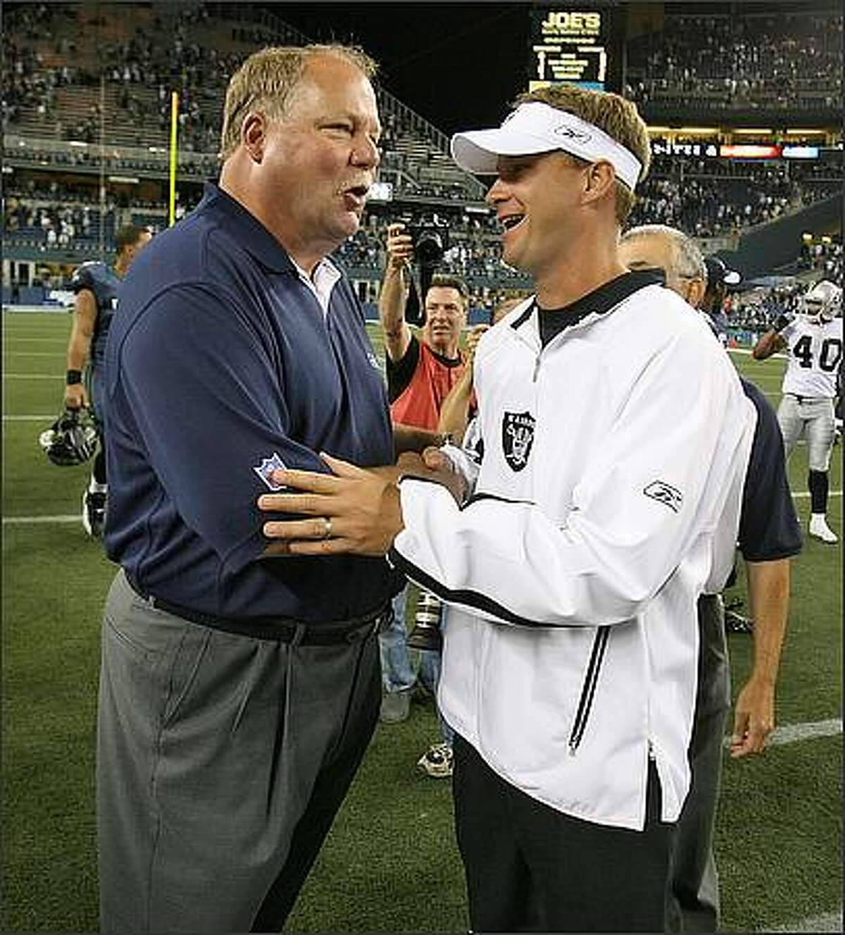 Seattle Seahawks head coach Mike Holmgren meets with Oakland Raiders Lane Kiffin after the Seahawks 19-14 win at Qwest Field in Seattle, Wash., Thursday August 30, 2007. Seattle Post-Intelligencer Photo by Mike Urban