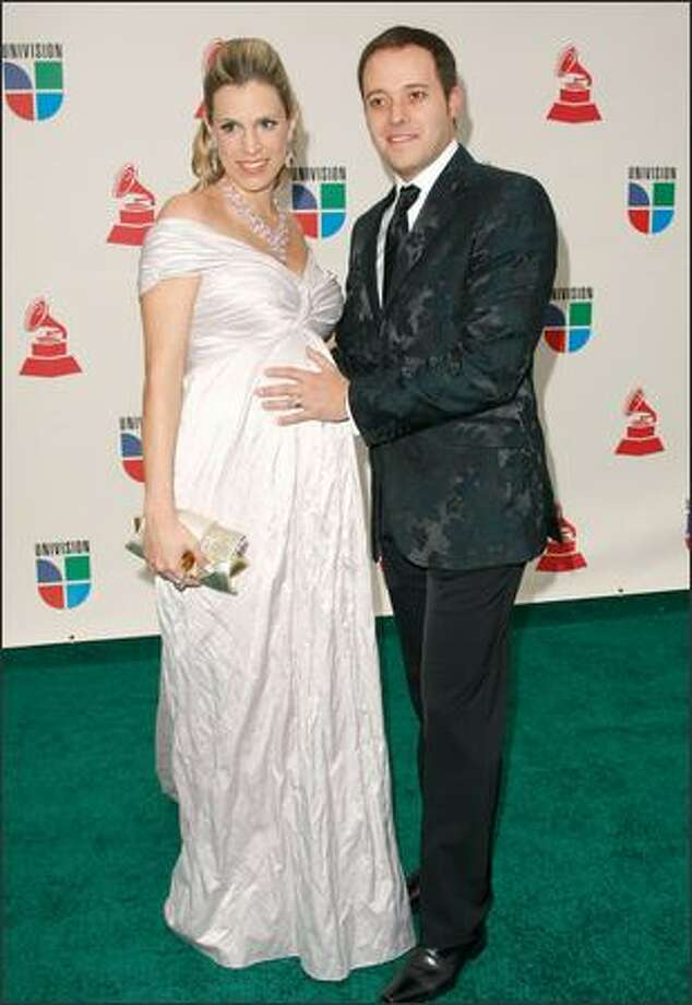 Musician Andre Valadao (right) and his wife Cassi arrive at the ninth annual Latin Grammy awards held at the Toyota Center in Houston on Thursday. Photo: Getty Images