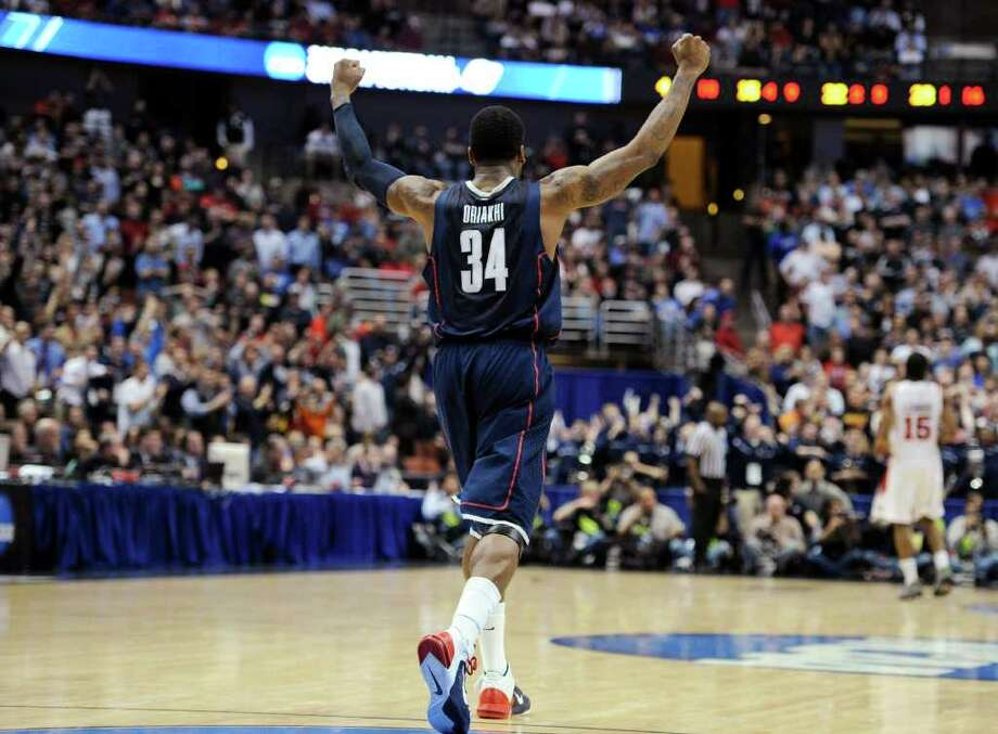 Connecticut's Alex Oriakhi (34) reacts after Connecticut's 74-67 win over San Diego State in a West regional semifinal in the NCAA college basketball tournament, Thursday, March 24, 2011, in Anaheim, Calif. (AP Photo/Mark J. Terrill) Photo: AP