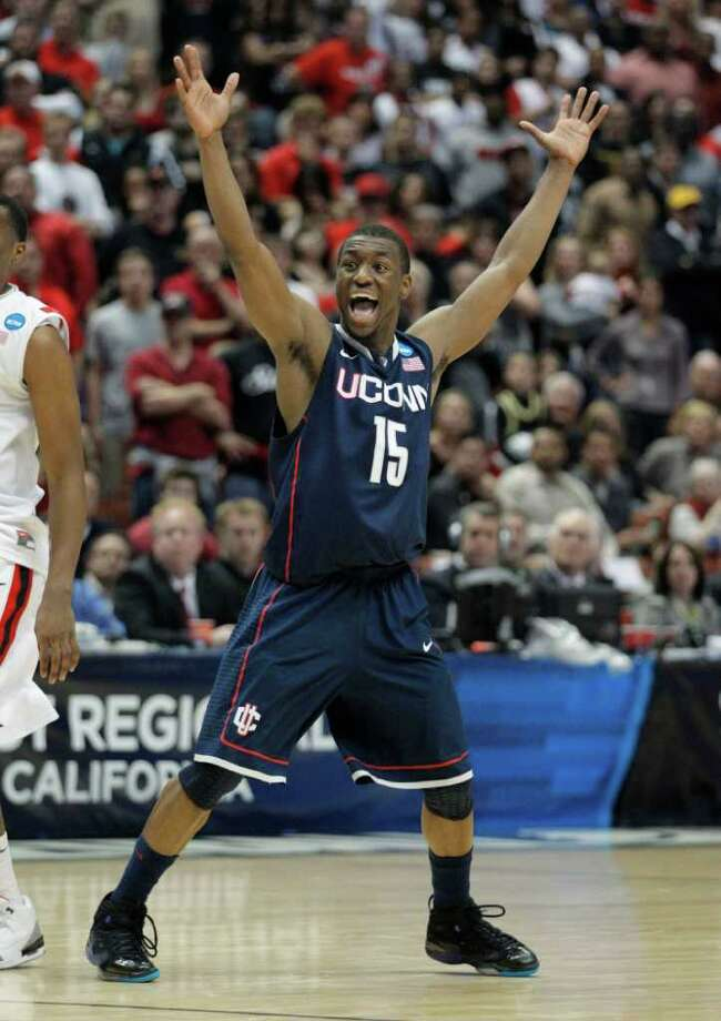 Connecticut's Kemba Walker celebrates his team's 74-67 victory over San Diego State in a West regional semifinal game in the NCAA college basketball tournament, Thursday, March 24, 2011, in Anaheim, Calif. (AP Photo/Jae C. Hong) Photo: AP