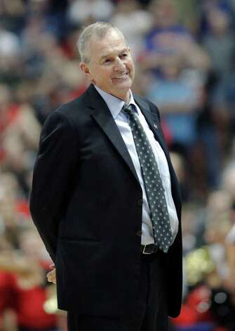 Connecticut coach Jim Calhoun smiles during the second half of Connecticut's 74-67 win over San Diego State in an NCAA college basketball tournament West regional semifinal, Thursday, March 24, 2011, in Anaheim, Calif. (AP Photo/Mark J. Terrill) Photo: AP