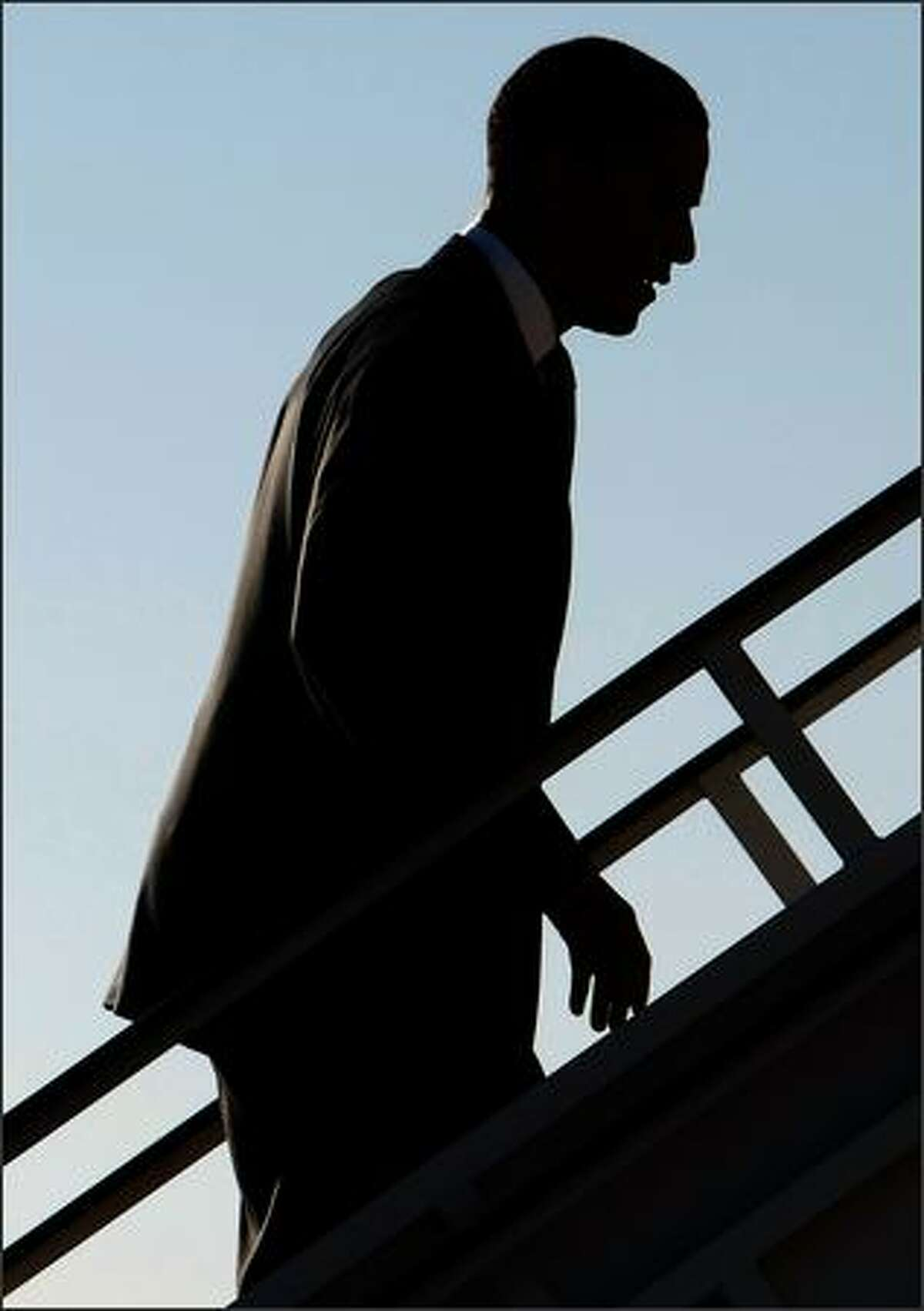 Democratic presidential candidate Sen. Barack Obama (D-IL) boards his campaign plane March 5, 2008 while departing San Antonio, Texas. Obama won only one of 4 primaries held yesterday as Sen. Hillary Clinton (D-NY) tightened the race considerably by winning Texas, Ohio and Rhode Island.
