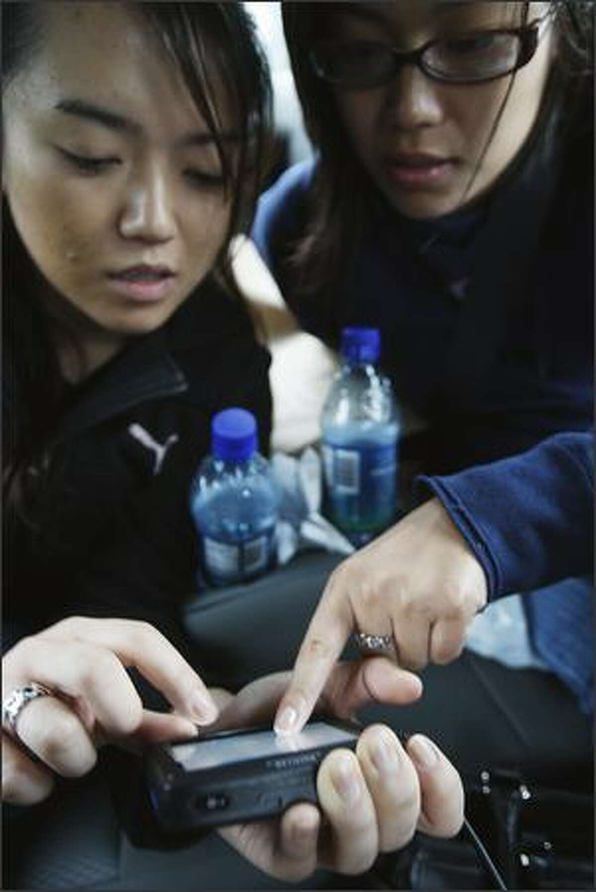 """Kelly Fujio and Masami Araki use their GPS to try and find the """"Cullen's"""" house on Nov. 7, 2008, in Forks, Washington. The three made a quick day trip over to Forks from Bremerton where they were in town for a friends wedding on Saturday."""