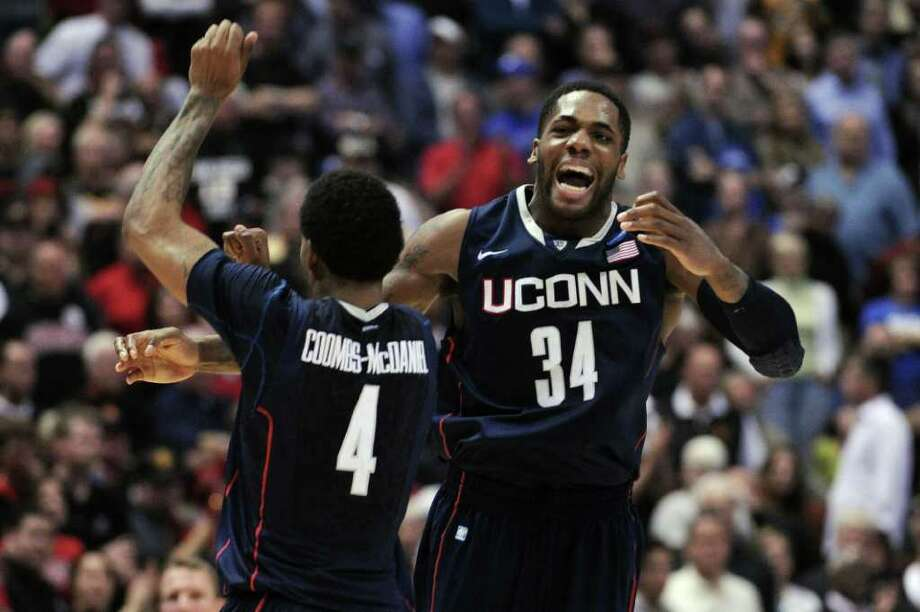 ANAHEIM, CA - MARCH 24:  Jamal Coombs-McDaniel #4 and Alex Oriakhi #34 of the Connecticut Huskies celebrate after defeating the San Diego State Aztecs during the west regional semifinal of the 2011 NCAA men's basketball tournament at the Honda Center on March 24, 2011 in Anaheim, California.  (Photo by Harry How/Getty Images) *** Local Caption *** Jamal Coombs-McDaniel;Alex Oriakhi Photo: Harry How, Getty Images / 2011 Getty Images