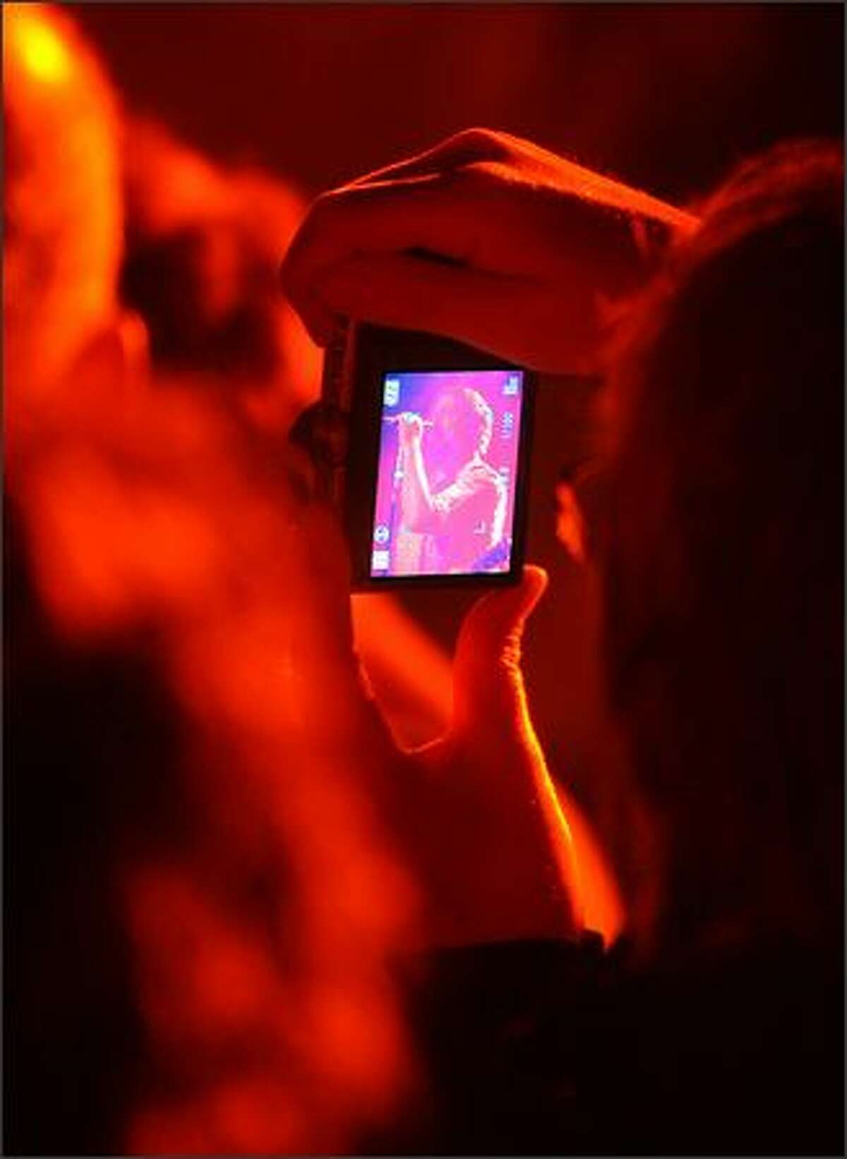 A fan snaps a picture of Patterson Hood of the Drive-By Truckers as they perform at the Showbox Sodo in Seattle on Thursday night.