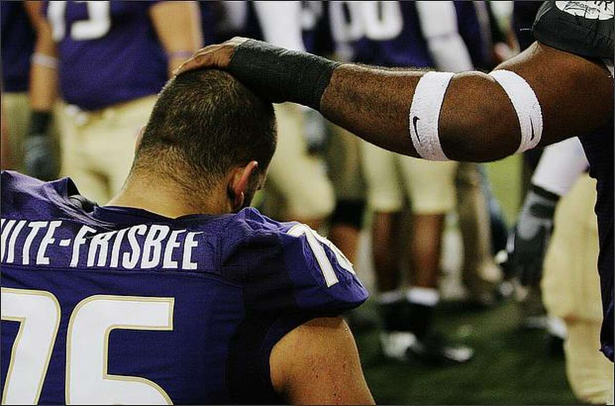 Jordan White-Frisbee is comforted by Husky teammate Ben Ossai near the end of the Husky's last home game of the 2008 season versus UCLA, Saturday, November 15, 2008.