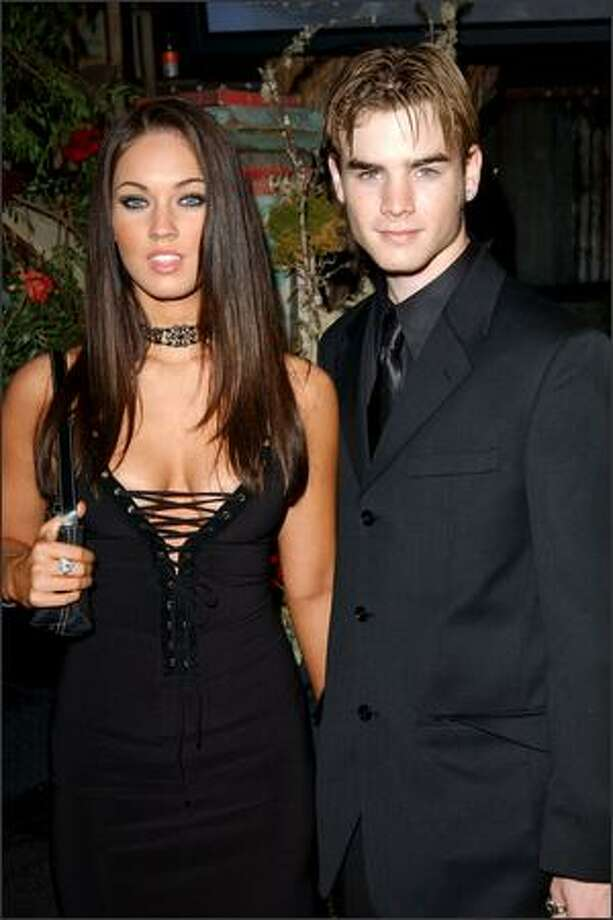 This is the 15th in an occasional series featuring stars and their ever-changing fashion styles. Tennessee-born actress Megan Fox, 22, is seen with her date, actor David Gallagher, in Los Angeles in March 2003. Fox is emblematic of a new generation of Hollywood stars; not yet truly successful, she is unlikely to be seen in a designer gown on the red carpet. Nonetheless, she brings her own youthful style and sexual appeal to numerous public events. Photo: Getty Images