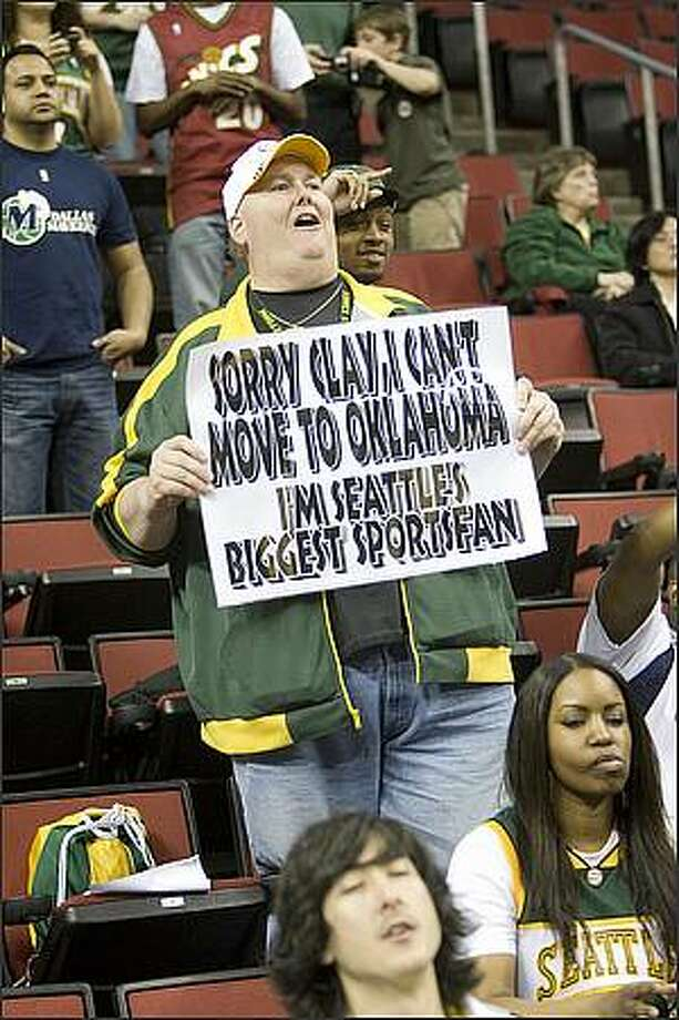 "Sonics fan Lorin ""Big Lo"" Sandretzky shows his feelings. Sonics fans show their feelings at what might be the last game in Seattle for the SuperSonics. The SuperSonics played the Dallas Mavericks in the Key Arena, Sunday, April 13, 2008. (photo/Grant M. Haller/Seattle Post-Intelligencer))."