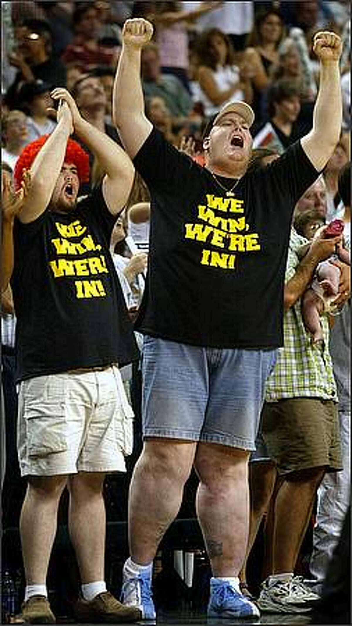 08/14/02 storm12 spts Seattle Storm fans Ian Murray and Lorin Sandretzky show their support late in the game against the Utah Starzz as the Storm beats them and gets their first playoff berth. Photo by Paul Kitagaki Jr./Seattle Post-Intelligencer (For Sports section - no reporter assigned)