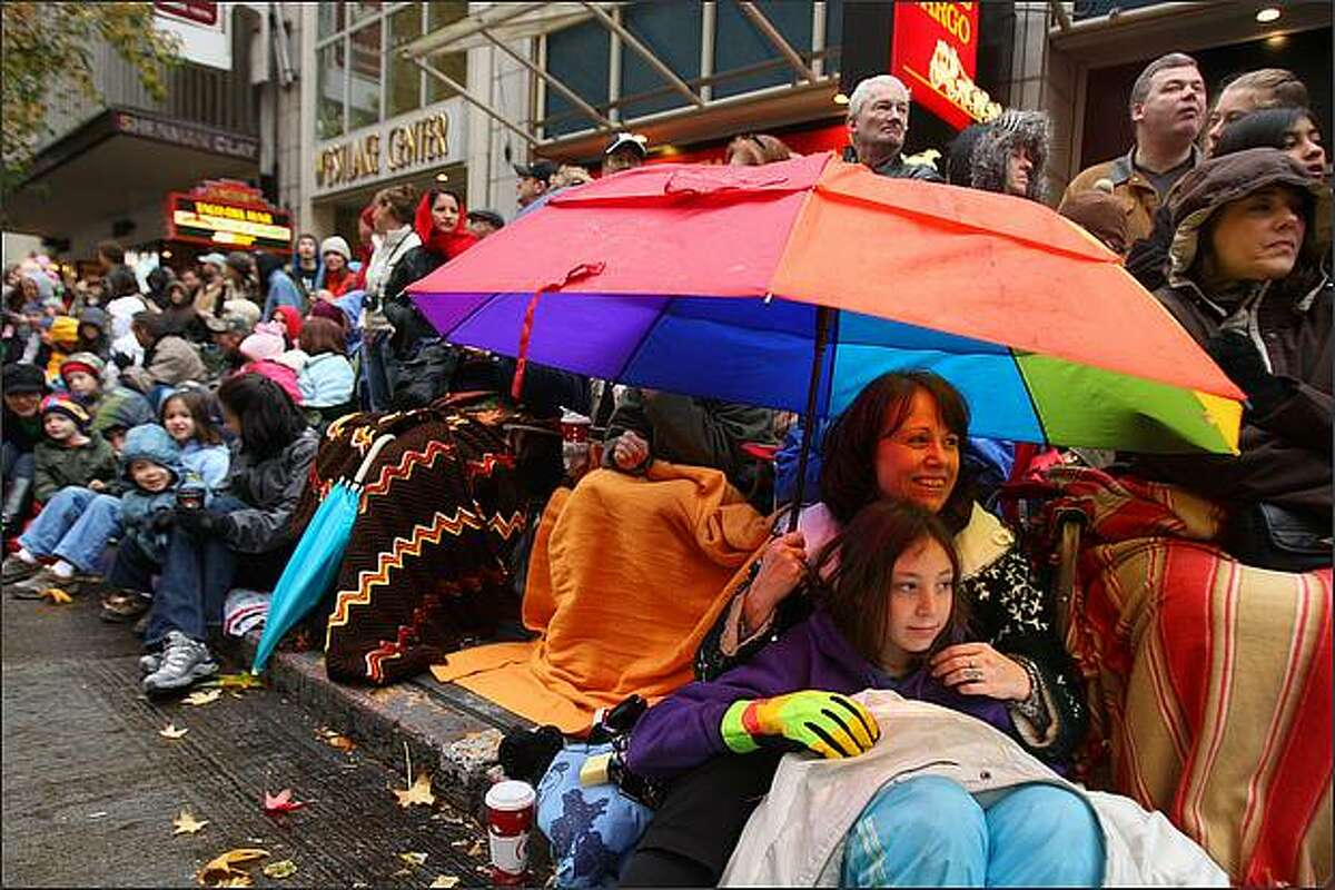 Rhonda Ward and daughter Danielle, from Federal Way, watch Seattle's annual Macy's Holiday Parade.