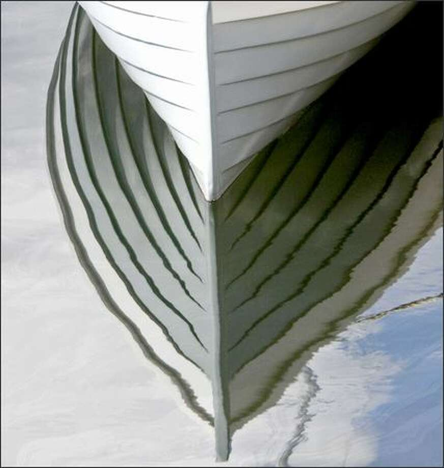 The lines of a Lake Oswego Boat are reflected in the water at the Center for Wooden Boats. Photo: Grant M. Haller, Seattle Post-Intelligencer