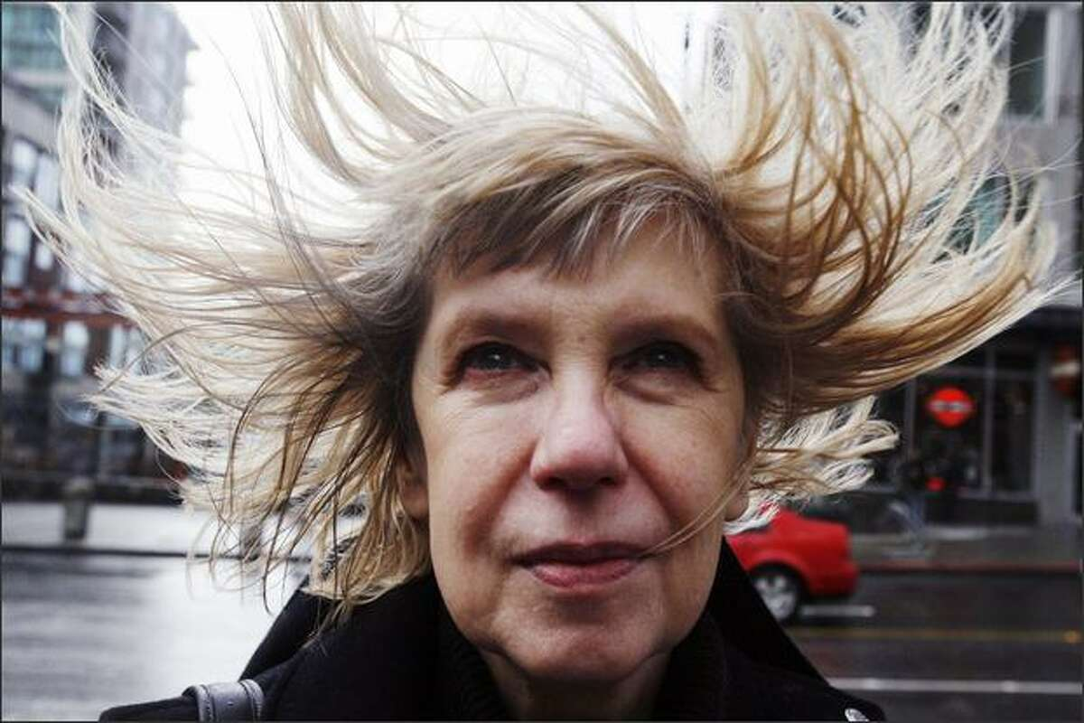 The wind blows through Olga Bourlin's hair as she stands on the corner of First Avenue and University Street.