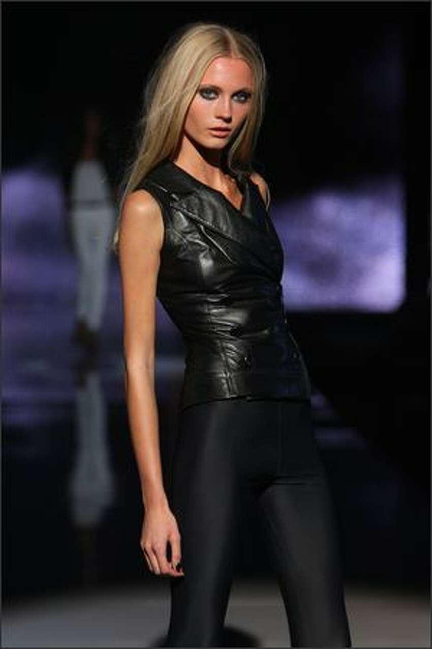 A model walks the runway at the Rock & Republic show.