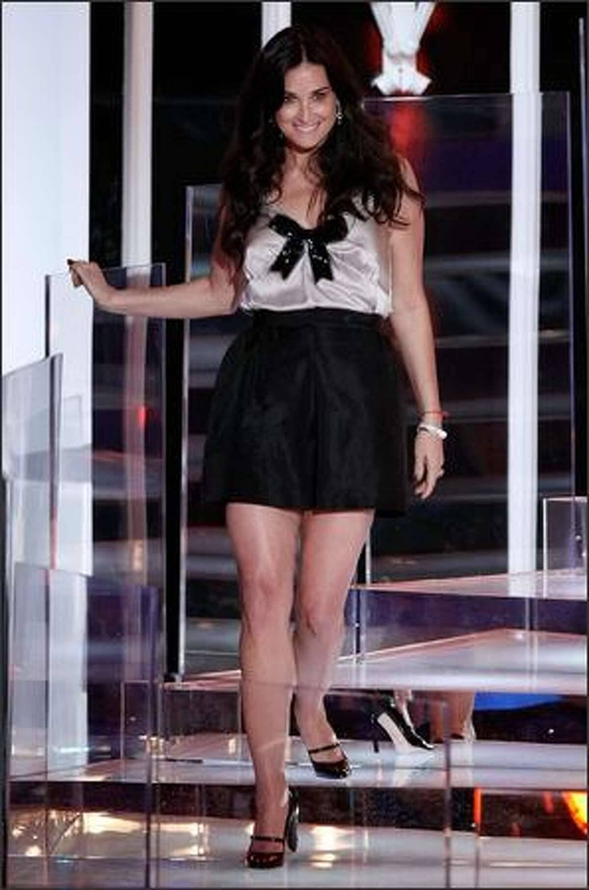 Actress Demi Moore walks onstage to read the nominees for the best male video.