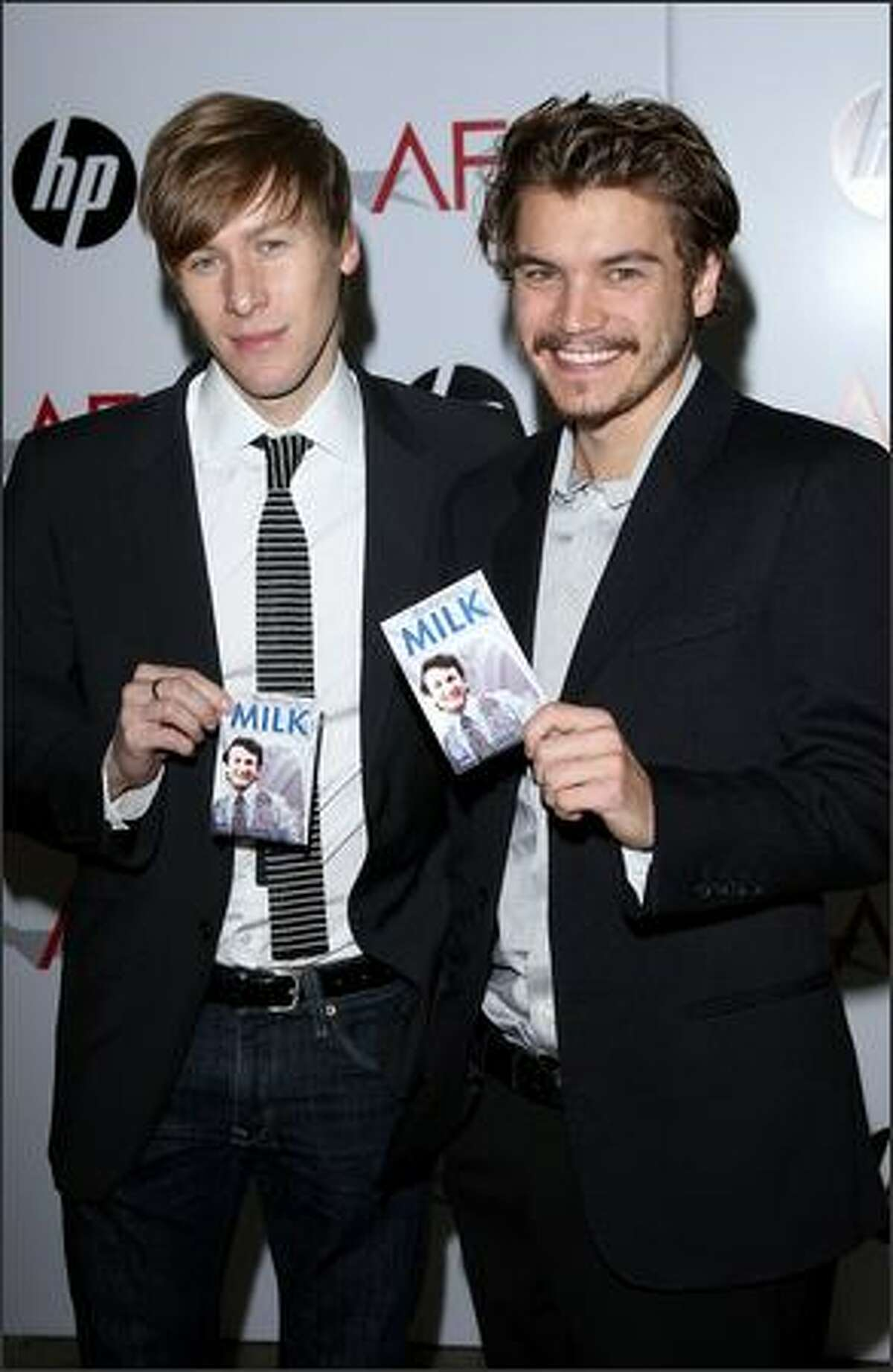Writer Dustin Lance Black (left) and actor Emile Hirsch arrive.
