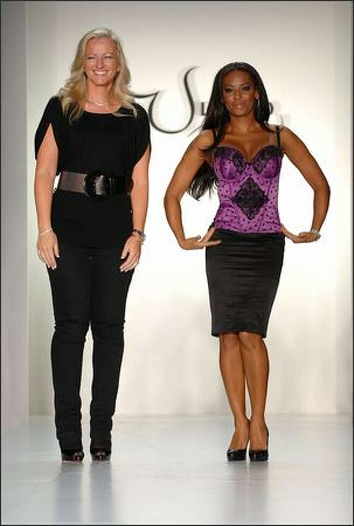 Ultimo Scottish designer lingerie brand founder Michelle, left, and pop singer Melanie Brown appear at the Mel B With Ultimo Spring 2009 fashion show during Mercedes-Benz Fashion Week at the Metropolitan Pavilion on Tuesday in New York City.
