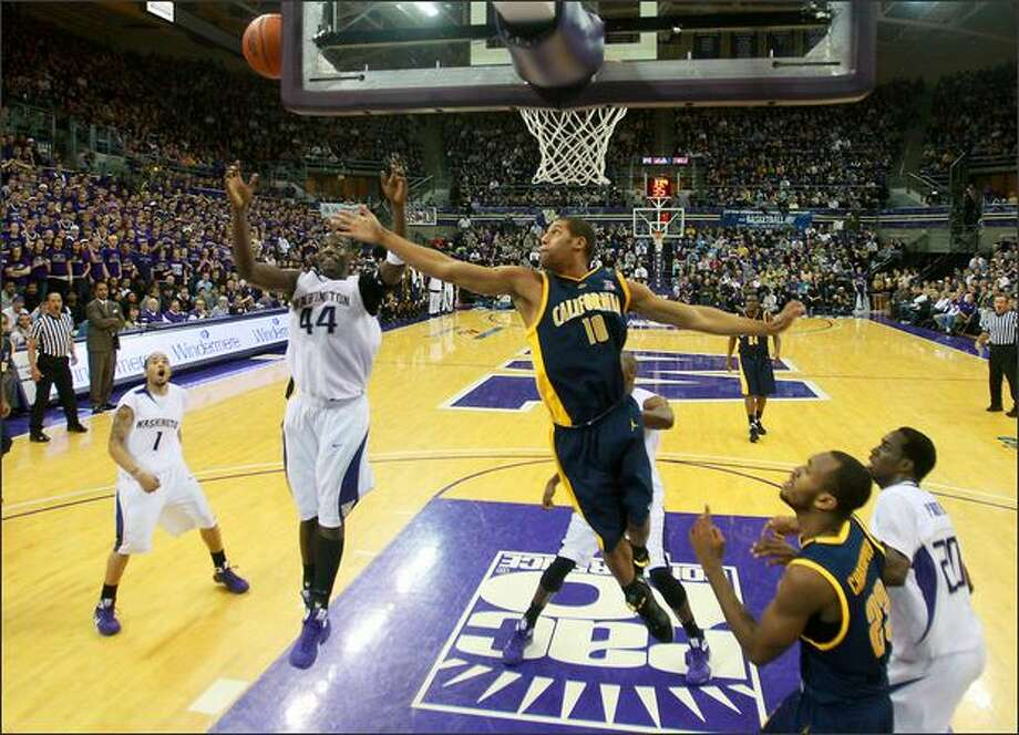 UW's Darnell Gant (44) and Cal's Jamal Boykin(10) battle for a rebound in the first half as the University of Washington Huskies play the California Golden Bears at the Bank of America Arena at Hec Edmunson Pavilion on the campus of the UW in Seattle on January 10,2009. (Scott Eklund/Seattle Post-Intelligencer) Photo: Scott Eklund/Seattle Post-Intelligencer