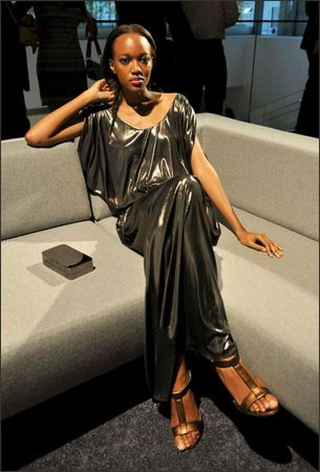 A model poses at the Halston presentation during Mercedes-Benz Fashion Week at the Museum of Modern Art in New York on Tuesday. The Halston label, which has been nearly dormant since its heyday in the 1970s, is attempting a comeback fueled by the investments of the likes of Hollywood movie mogul Harvey Weinstein. Photo: Getty Images