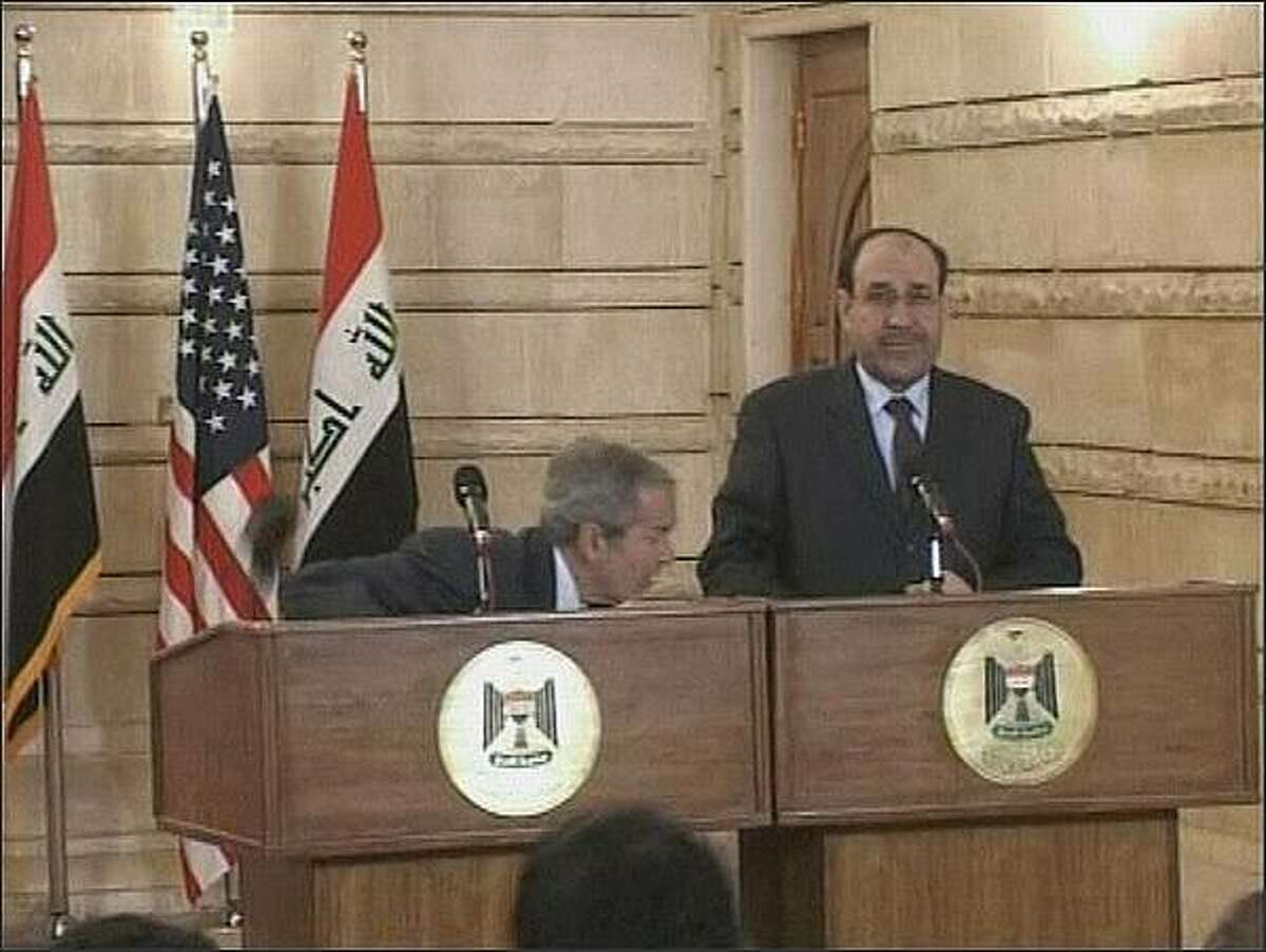In this image from APTN video, US President George W. Bush, left, ducks as a man throws a shoe at him, during a news conference with Iraq Prime Minister Nouri al-Maliki in Baghdad, Iraq. On an Iraq trip shrouded in secrecy and marred by dissent, President George W. Bush on Sunday hailed progress in the war that defines his presidency and got a size-10 reminder of his unpopularity when a man hurled two shoes at him during a news conference. (AP Photo)
