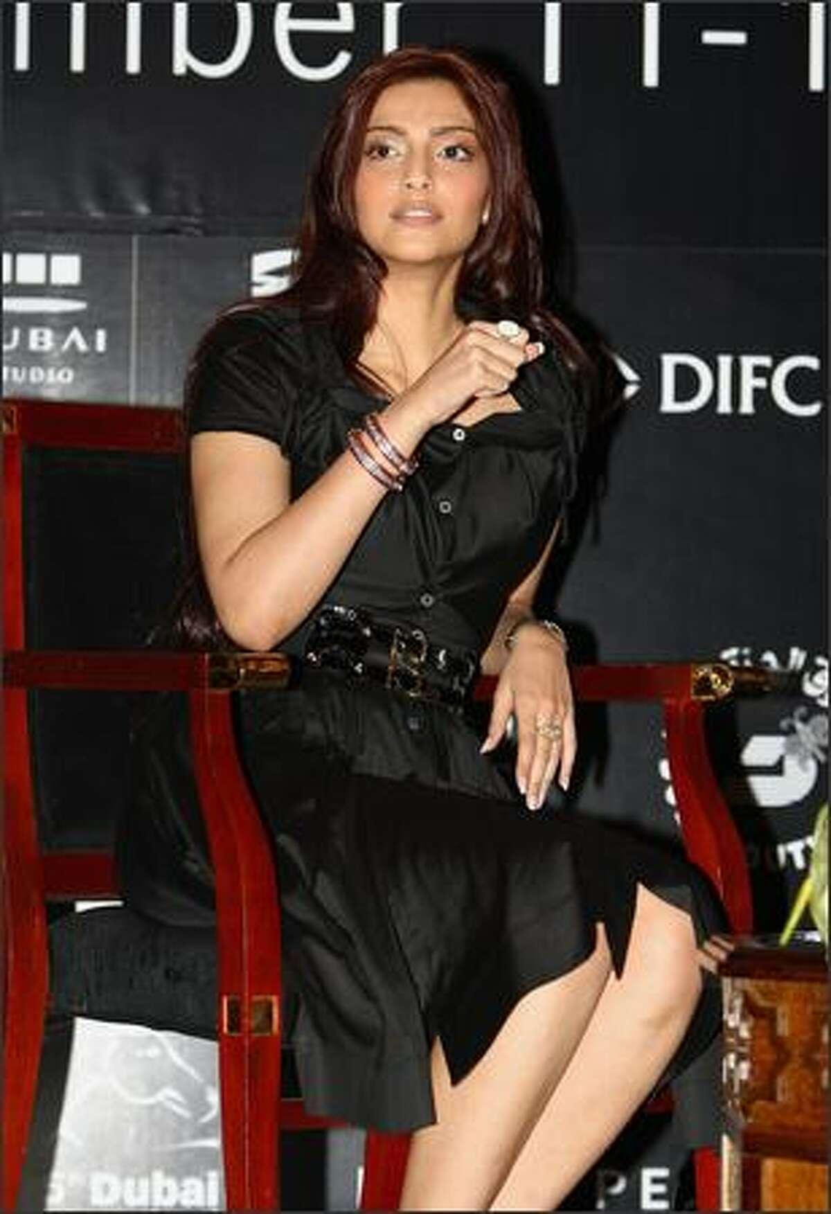 Actress Sonam Kapoor speaks during the