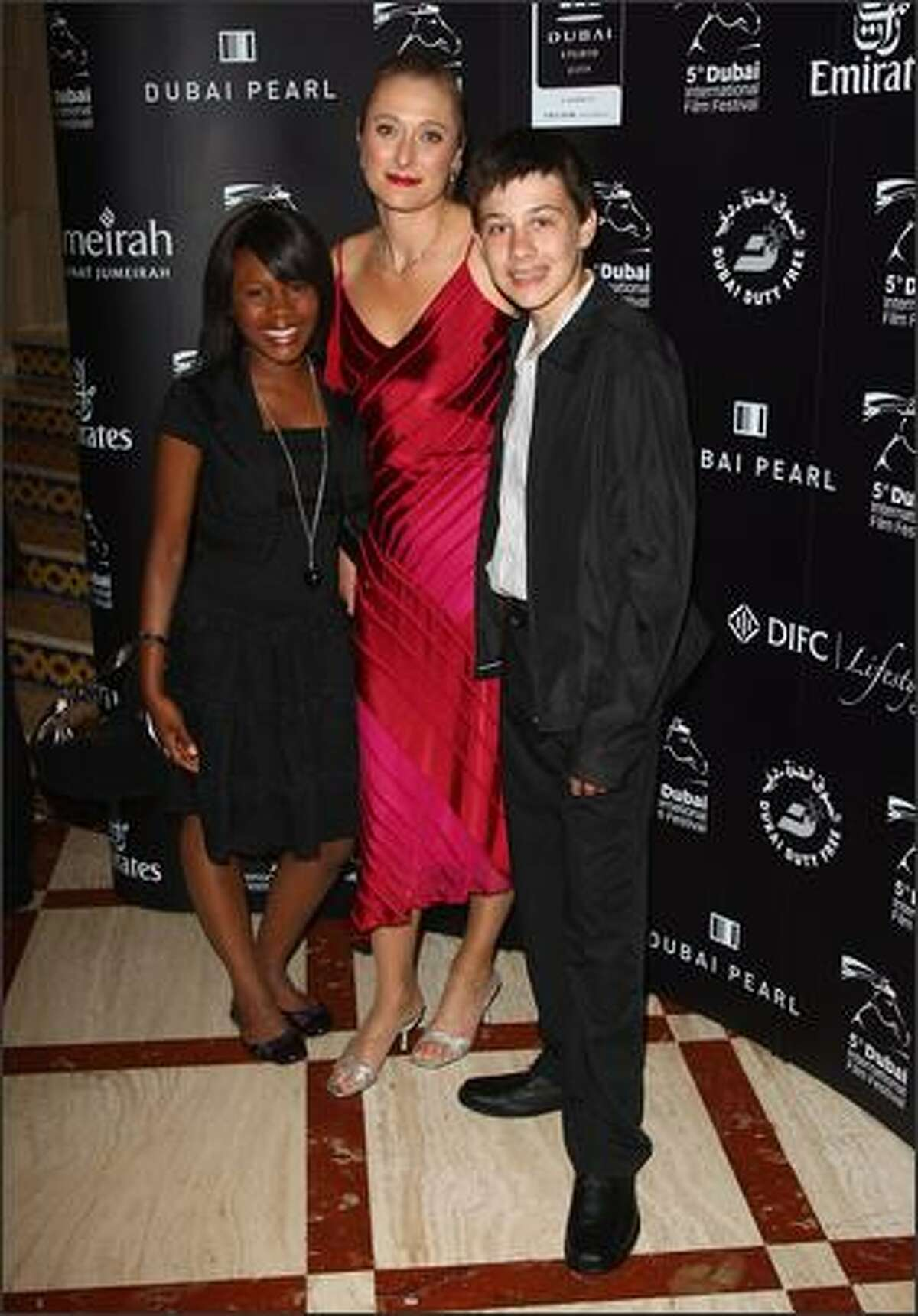 Actresses Ketrice Maitisa, Caroline Goodall and actor Johann Harmse attend the